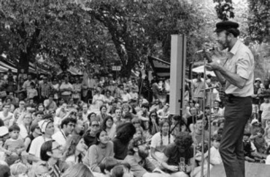 """The late Pete Seeger, a folk singer and left wing icon – seen in the photo performing at the Washington Monument on the first Earth Day in 1970 – wrote a song for Paul Ehrlich's Zero Population Growth organisation (""""We'll All Be A-Doubling"""", 1969). Seeger publicly appealed to Ehrlich and Barry Commoner to sink their differences in pursuit of environmentalist aims. """"Commoner has convinced me that technology and our private profit politics and society must be radically changed and quickly,"""" wrote Seeger. """"But I'm still working hard for Zero Population Growth. … Achieving ZPG will be good education for everyone. Everyone can and must cooperate.""""[6] Seeger's sympathy for Ehrlich's aggressively Malthusian arguments is a reminder of how deeply these ideas were embraced not only by the right, but also by sections of the left."""