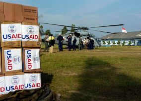 This image has an empty alt attribute; its file name is 800px-usaid-helicopter-indonesia.jpg