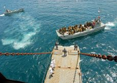Members_of_the_Papua_New_Guinea_Defense_Force_prepare_to_embark_aboard_the_Royal_Australian_Navy_landing_ship_heavy_HMAS_Tobruk_(L50)