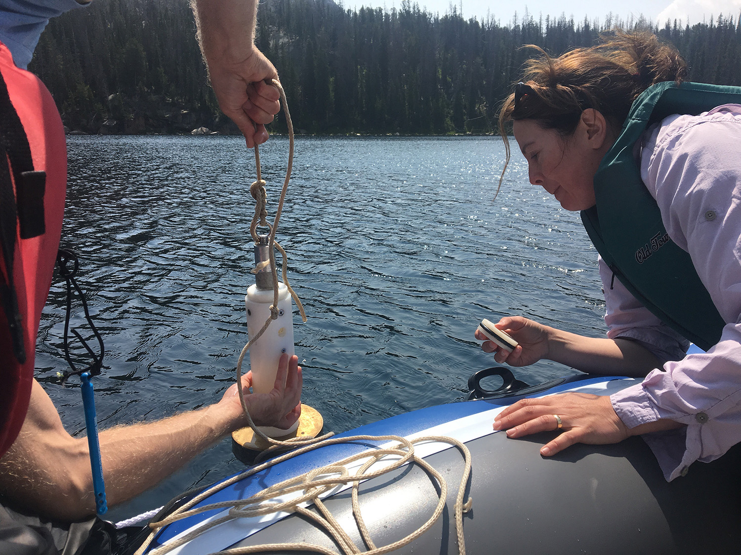 Pulling up sediment corer from Beauty Lake.