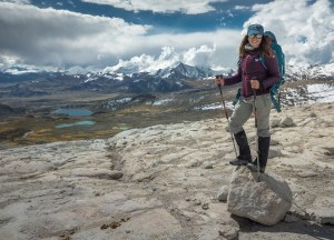 Heather Clifford, posing next to a view of the Peruvian Andes while trekking up to the Quelccaya ice cap
