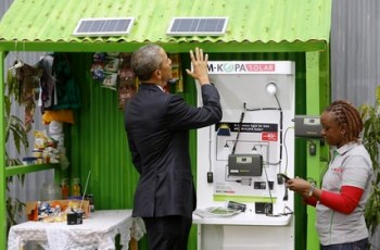President Obama in Kenya checking out a solar panel.