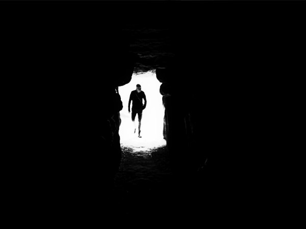 Darkness Visible: H sapiens, entering the Long Barrow, West Kennet<br /> Photograph: Mark Goldthorpe