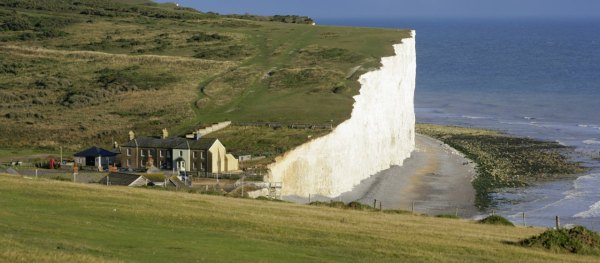 When to let go? Coastguard cottages at Birling Gap, Seven Sisters, East Sussex. Photograph by National Trust Images / John Miller