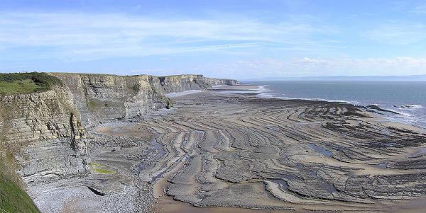 Wavecut platform caused by the sea's erosion of cliffs at Southerndown, Bridgend, South Wales