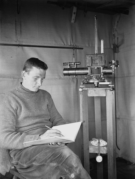George Clarke Simpson, making scientific observations in the magnetic hut during the Terra Nova Expedition
