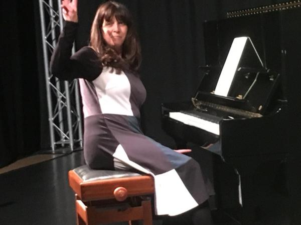 Photograph showing Lola Perrin at the piano for ClimateKeys at Sheffield Festival of Debate in 2019