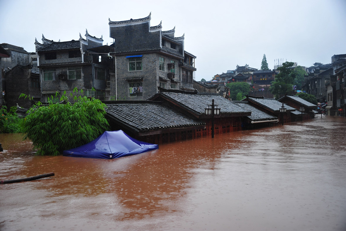 Buildings in the ancient town of Fenghuang are submerged in flood water. Getty