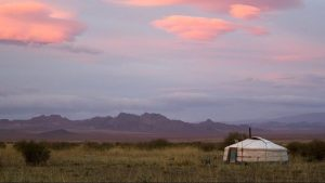 lonely mongolian yurt in countryside during sunrise
