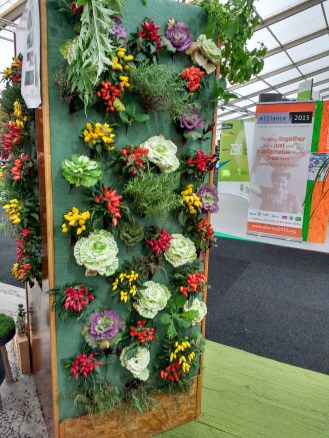"""While there were indeed cases highlighted by media of """"false solutions"""" and """"greenwashing"""" at COP21, the CGA showcased many ideas (such as this food wall) which are practical and feasible for citizens to use today. Other highlights included attractive, sturdy furniture built from waste materials (""""upcycled"""") and new innovations in land/air/sea monitoring using autonomous/semi-autonomous machines, powered independently for long-range and low-emission data collection."""