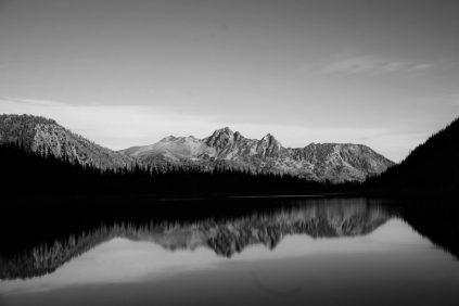 Mt. Cashmere reflects in a still Colchuck Lake.