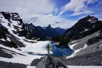 Logan splits Iceberg Lake, Thompson Peak behind.