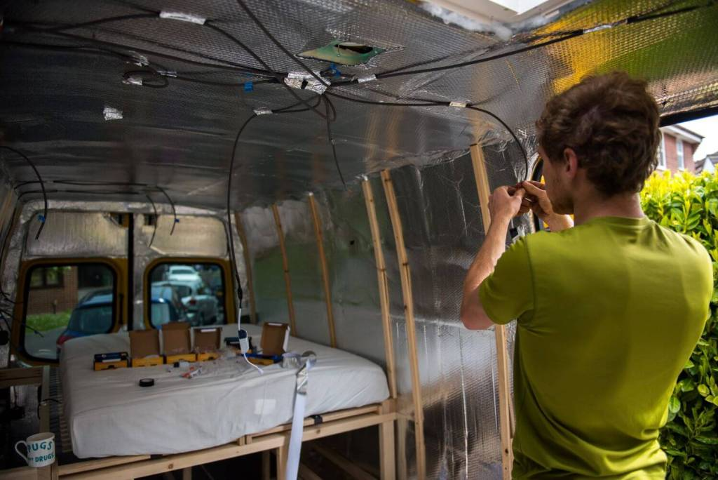 Thin wooden battens screwed into the walls of the van, ready to have cladding attached to them!