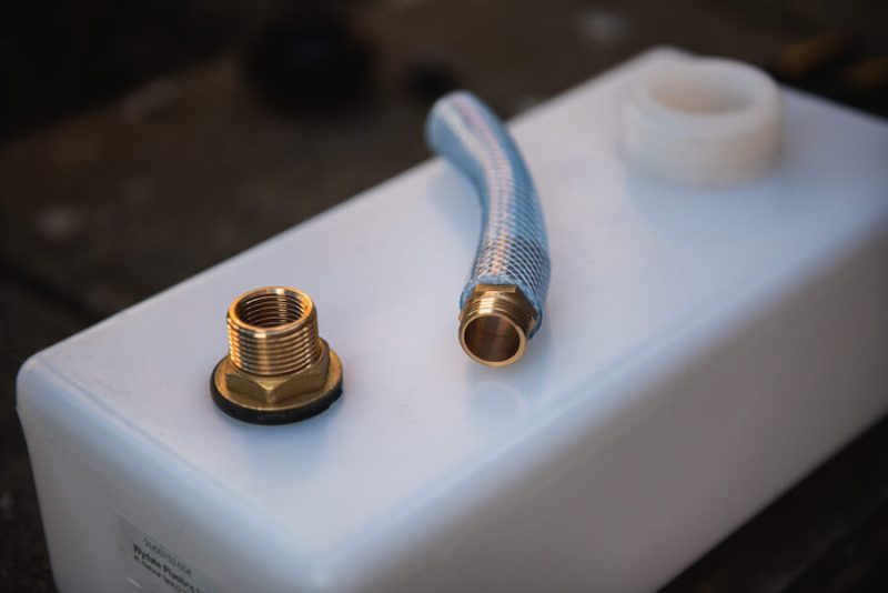 components to make a diy composting toilet in a campervan - tank connector and hose
