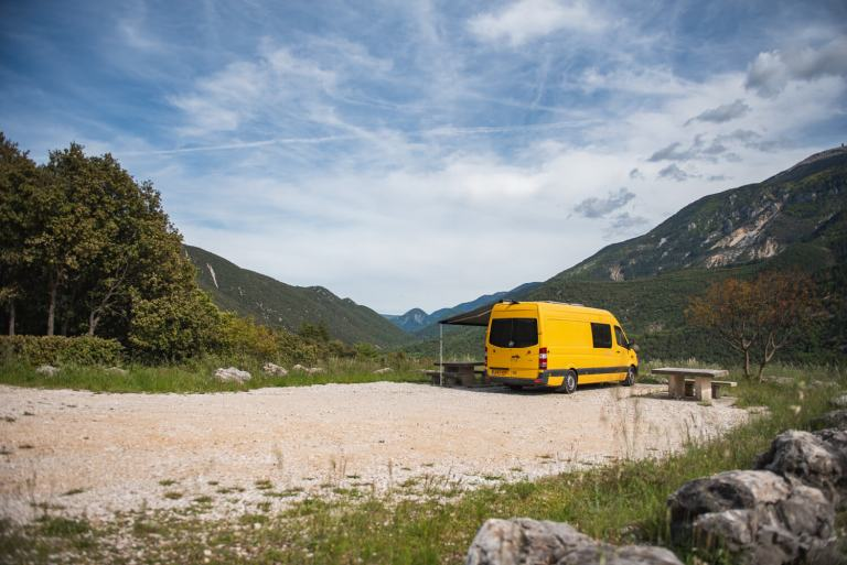 yellow mercedes sprinter campervan with a dometic awning