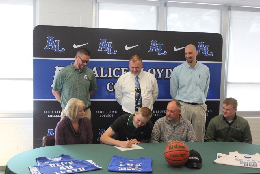04-06-2018 Eastside Colyn Sturgill sign with Alice Lloyd