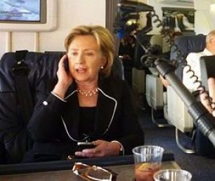 """During a trip to the Middle East, Clinton is seen using two Blackberrys while being filmed for a National Geographic documentary called """"Inside the State Department"""" on June 15, 2010. (Credit: National Geographic)"""