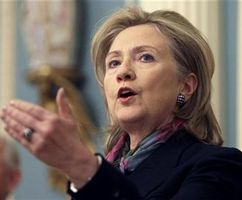 Secretary of State Hillary Clinton gestures as she delivers a statement about WikiLeaks lead at the State Department in Washington November 29, 2010.REUTERS/Yuri Gripas