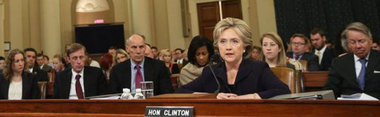 Sitting behind Clinton at the Benghazi committee hearing are, starting left in order of appearance, Heather Samuelson, Jake Sullivan, (unidentified man), Cheryl Mills, Katherine Turner and David Kendall. (Credit: Getty Images)