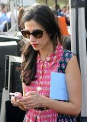 Huma Abedin stops for a moment to text a message. (Credit: Polaris)