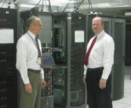 Ernie Milner, division chief for SMART Testing and Implementation, and Kevin Gatlin, division chief for SMART Messaging, in the State Department SMART lab in Newington, VA. (Credit: American Diplomacy / University of North Carolina)