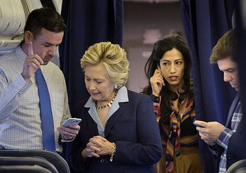 On the same day Anthony Weiner's electronic devices were seized, the Clinton campaign team are on their way to a rally in Akron, OH on October 3, 2016. (Credit: Agence France Presse / Getty Images)