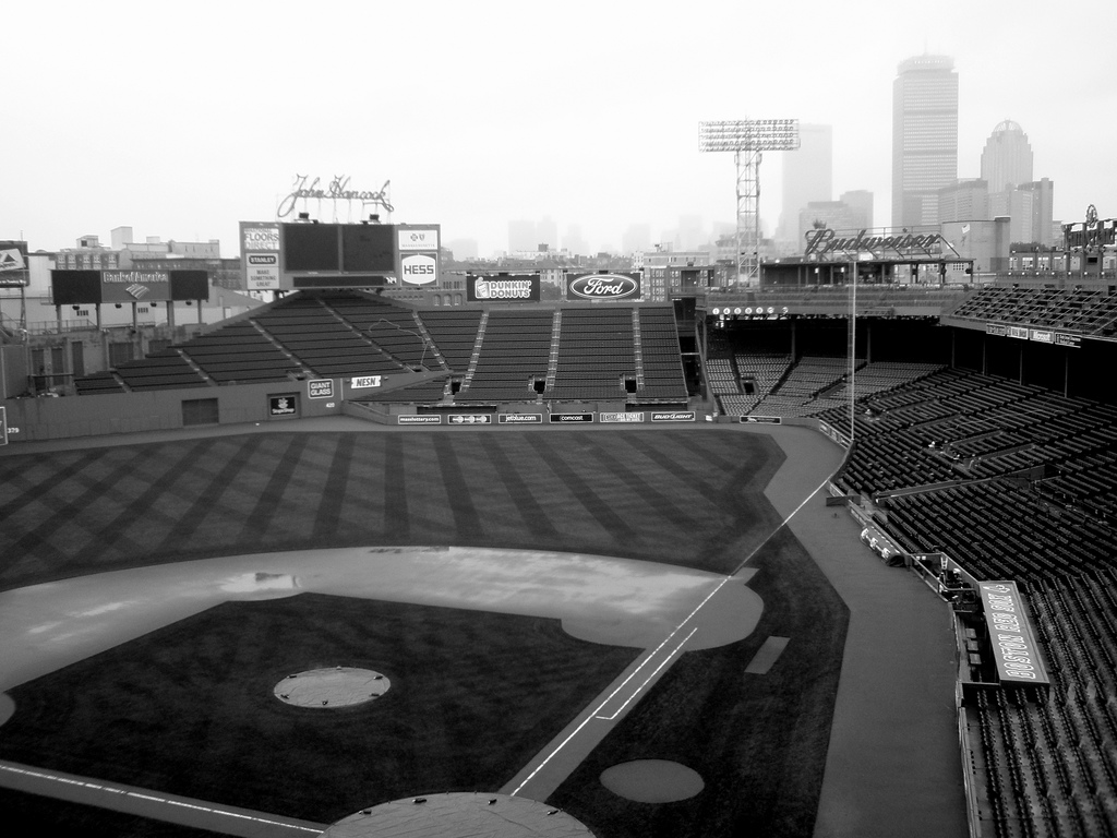 The Fenway Park Baseball Diamond And Boston Buildings