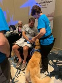 Rick meeting service dog