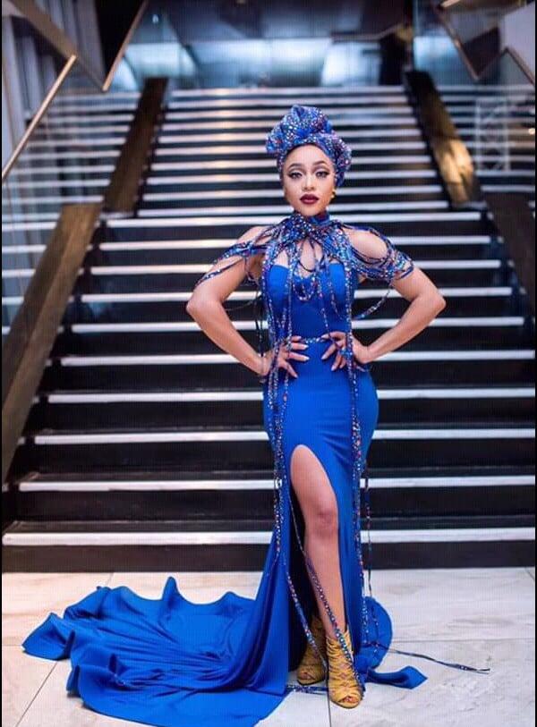 Thando Thabethe on Blue Dress with African Print Neckpiece, Cape ...