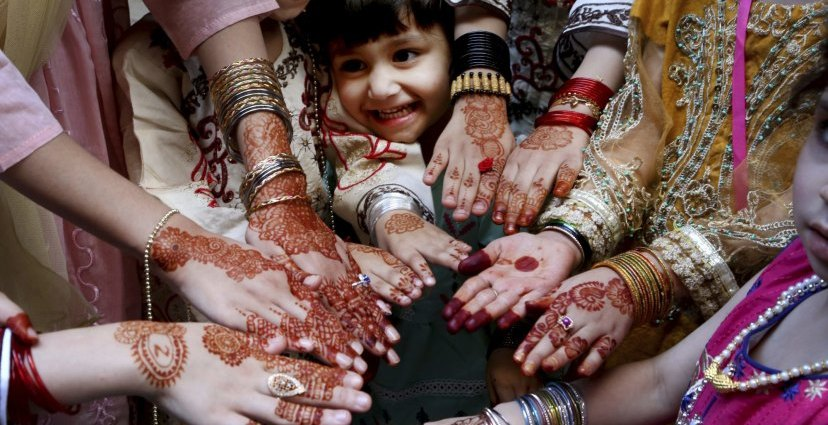 Muslims girls display their hands painted with traditional henna to celebrate Eid al-Fitr holidays, marking on the end of the fasting month of Ramadan, in Peshawar, Pakistan.CREDIT:AP