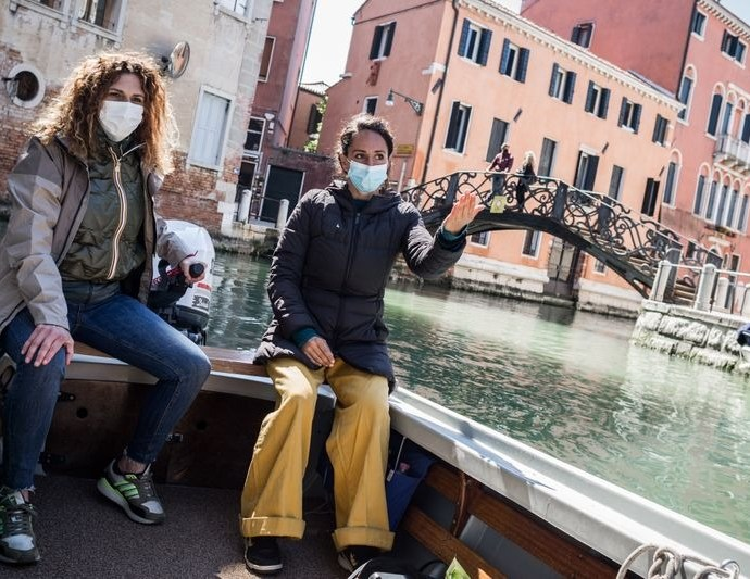 Boating instructor Marta Canino steers her way through the canals of Venice with her student Sara.