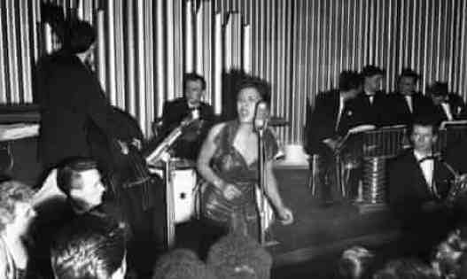 Billie Holiday in concert in Britain, 1954. Her later performances of Strange Fruit could be agonising to watch. Photograph: Charles H Hewitt/Hulton-Deutsch Collection/Corbis