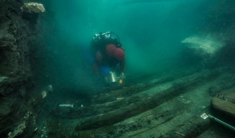 A diver examines the remains of an ancient military vessel discovered in the Mediterranean sunken city of Thonis-Heracleion off the coast of Alexandria, Egypt, in this handout image released on July 19, 2021. The Egyptian Ministry of Antiquities/Handout via REUTERS