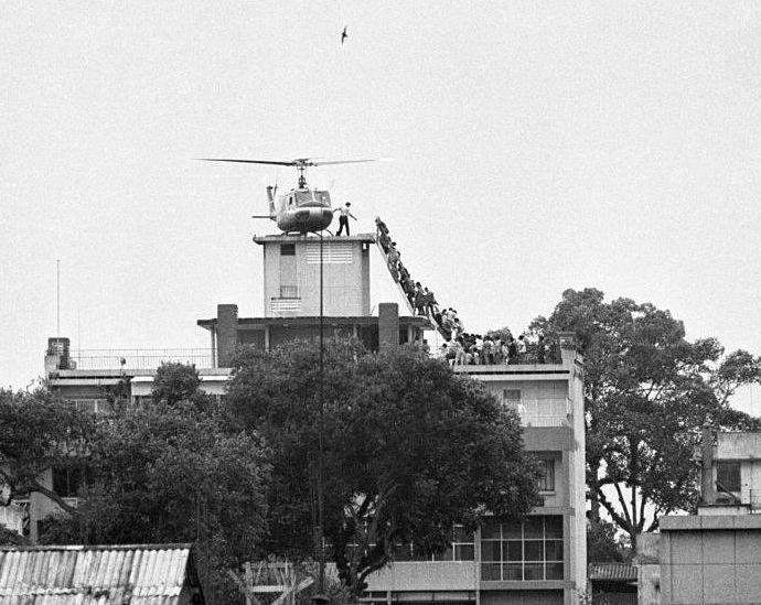 In the iconic photo from 1975, people are seen boarding a helicopter on the roof of the CIA station in Saigon