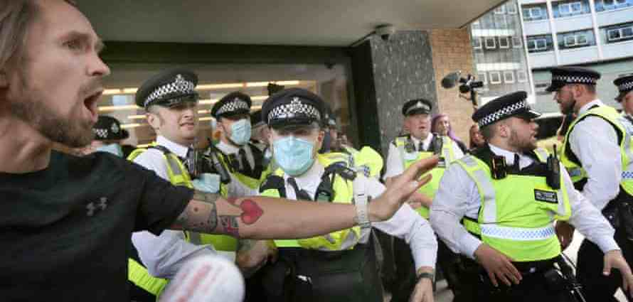 Police officers try to stop protesters from accessing the Studioworks site in west London. Photograph: Martin Pope/SOPA Images/Rex/Shutterstock