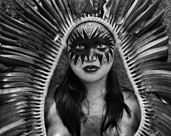 Bela Yawanawá, from the village of Mutum, with a headdress and painted face. Rio Gregório indigenous territory, Acre, Brazil, 2016. Photograph: © Sebastiao Salgado/nbpictures.com