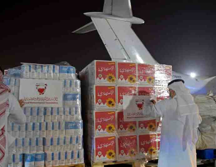 Volunteers label a shipment of humanitarian aid to be sent to Afghanistan at Bahrain international airport. There are hopes Kabul airport will reopen soon. Photograph: Mazen Mahdi/AFP/Getty Images