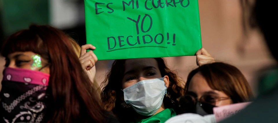 """A woman holds up a banner which reads """"My body, I decide"""" during a protest to celebrate the decision of the Supreme Court of Justice of the Nation (SCJN) that declared the criminalization of abortion as unconstitutional, in Saltillo, Mexico September 7, 2021. REUTERS/Daniel Becerril"""