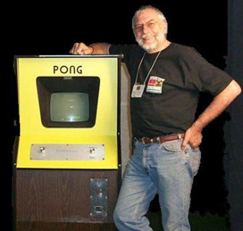 nolan-bushnell-next-to-pong-arcade-machine2