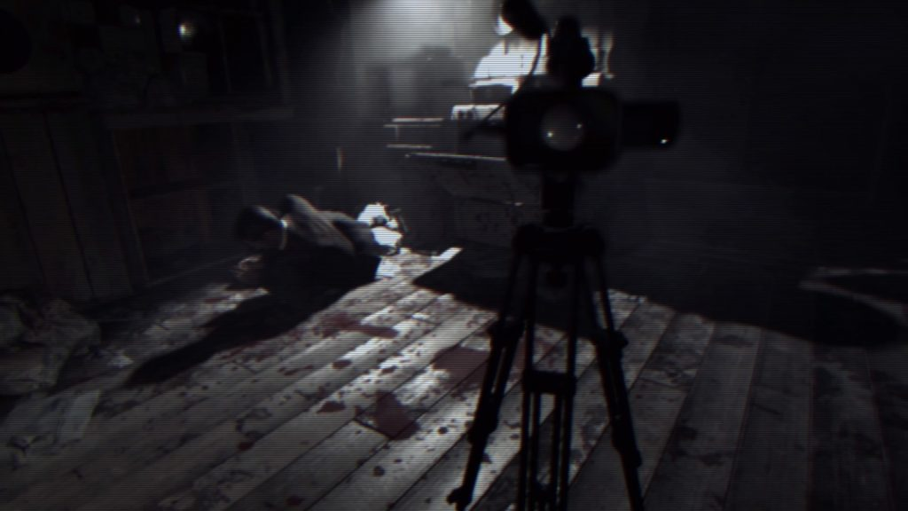 a bloodied body and a digital camera in beginning hour