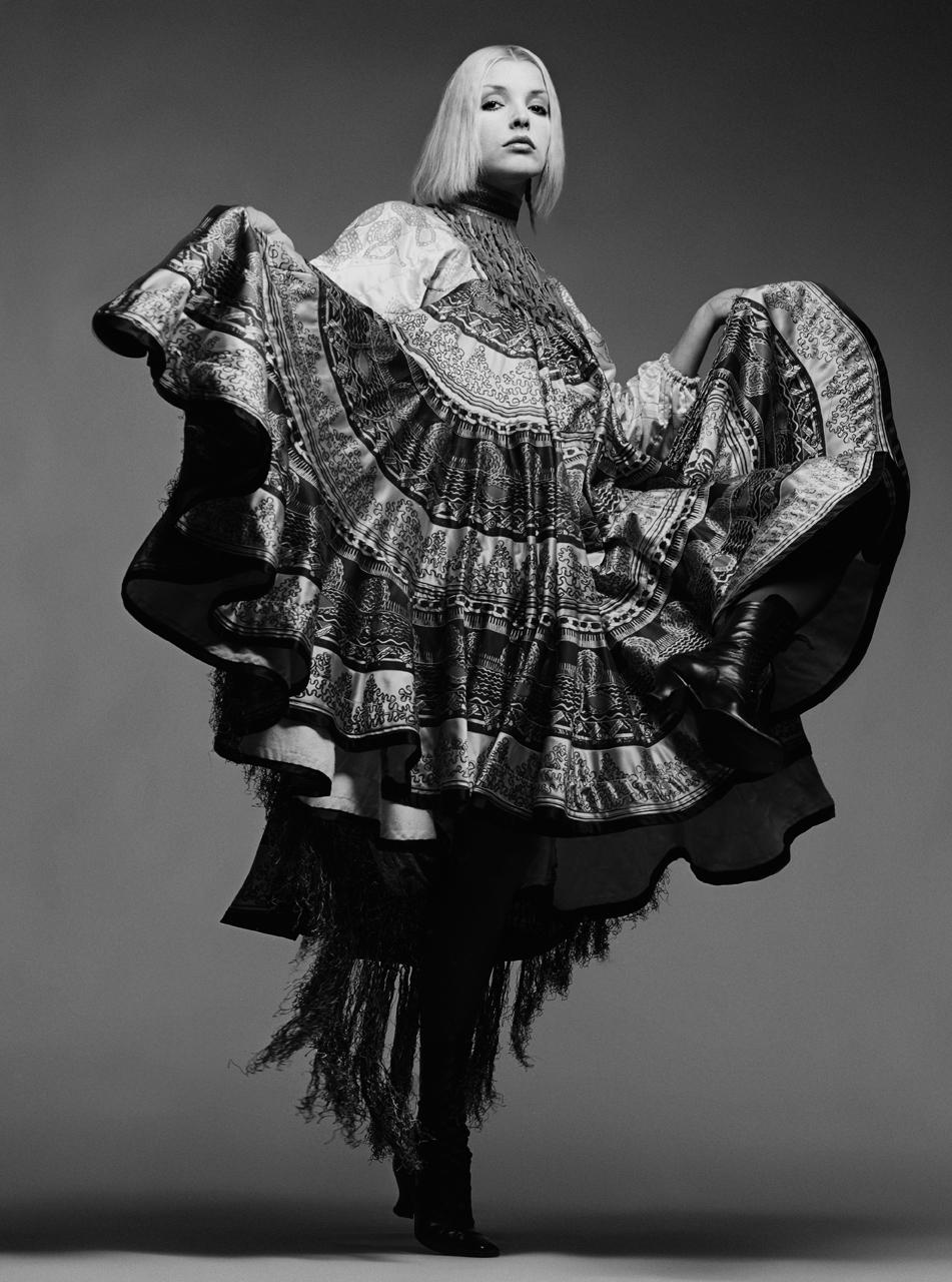 Geshe1-Vogue-holding-dress-up.jpg