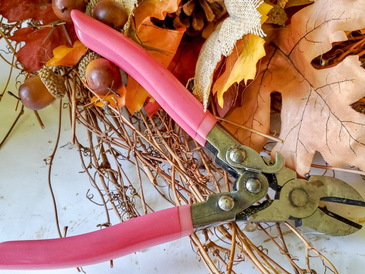 These wire cutters are to snip the edges of the branches on the wreath