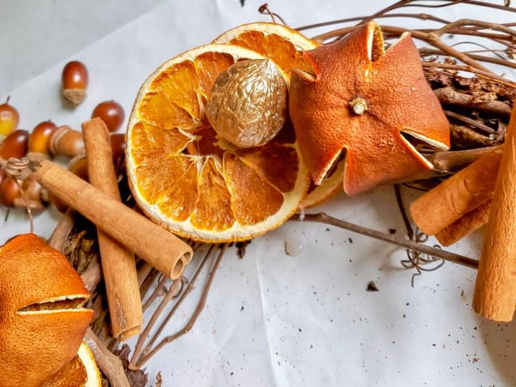 Oranges, cinammon sticks and walnut after gluing