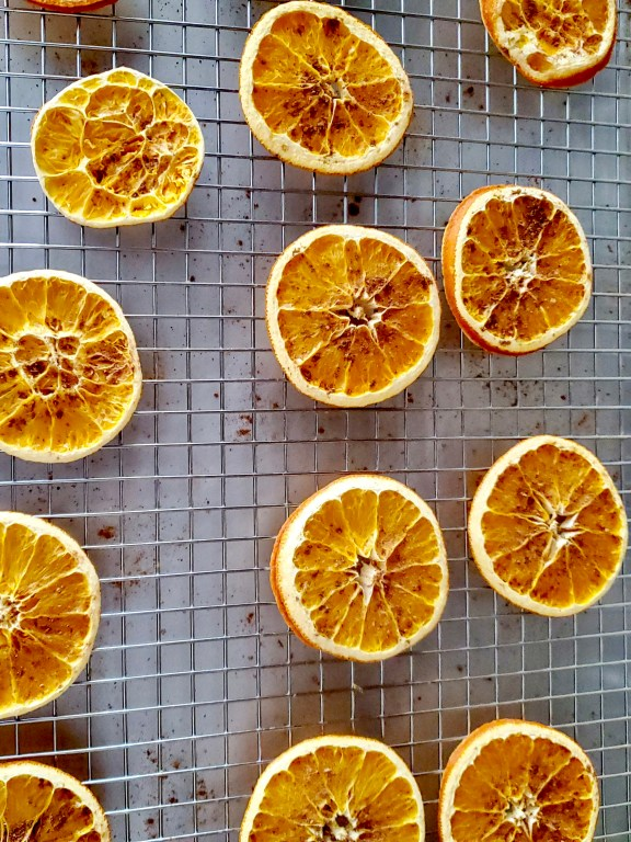 Orange slices going into the oven to dry.  Spices were added before being dried