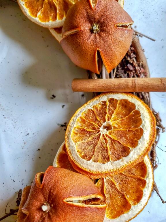Dried oranges with one cinnamon stick glued