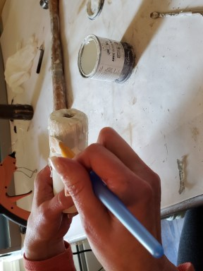 painting the drips on the rustic DIY to blend