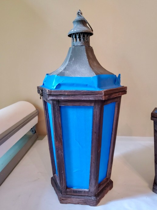 Lantern glass taped to keep clean when adding the wax