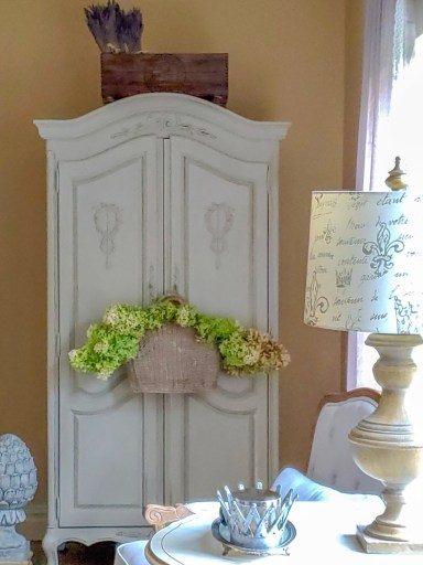 Armoire with hydrangeas in a hanging basket