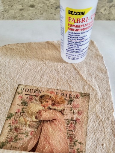 The bottle of fabric glue and the stocking showing the transfer