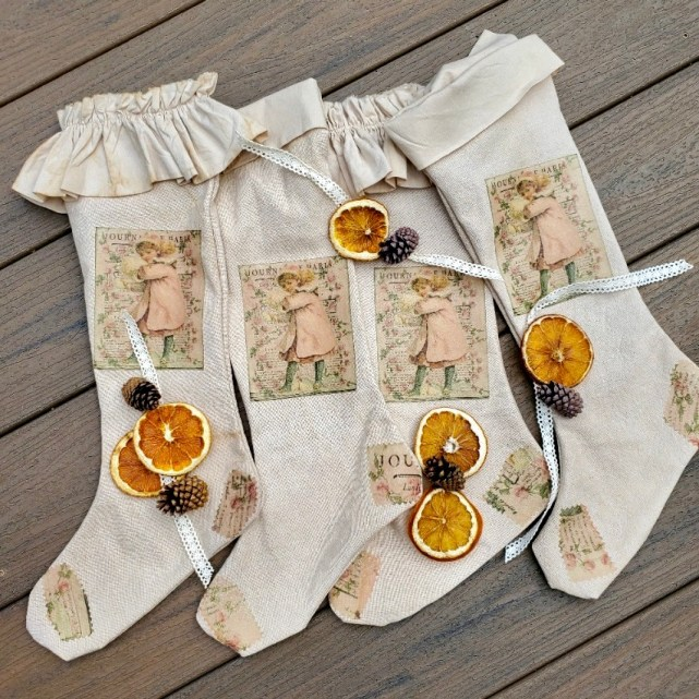 All four stockings with orange slices, pinecones and lace ribbon